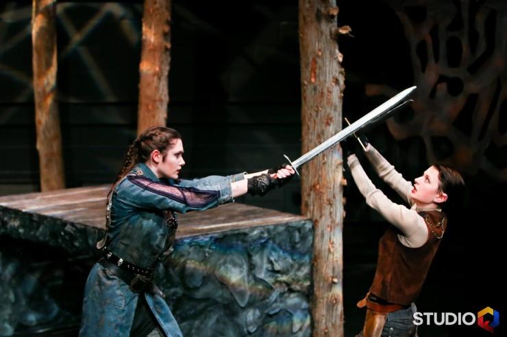 Two women sword fighting
